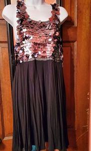 Larok Black dress with large metallic on top